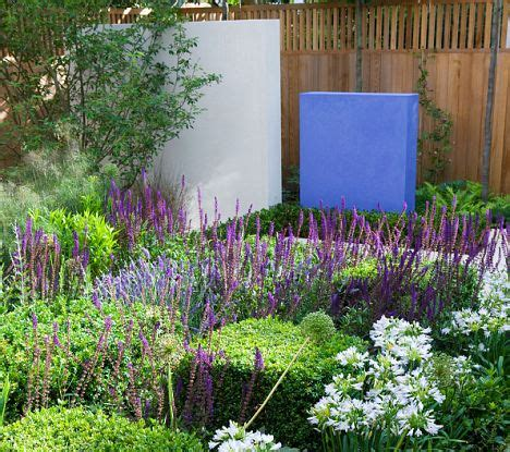 Rectangular Kitchen Ideas clean lines and limited colours make this garden a