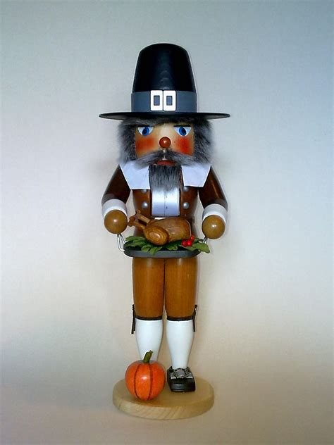 pilgrim man with turkey german wood thanksgiving day