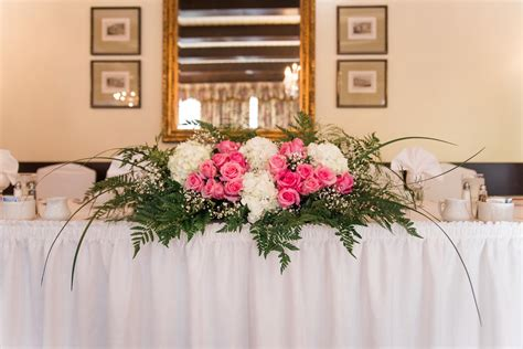 Arranging Wedding Flowers by Toronto Wedding Flowers Florido Table Arrangement