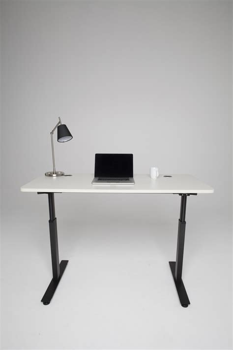 affordable sit stand desk the s most affordable quot automatic quot sit to stand desk