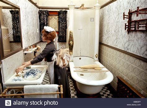 maid in bathroom a maid in victorian dusts in period costume a victorian