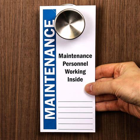 maintenance personnel working inside 2 sided door hanger