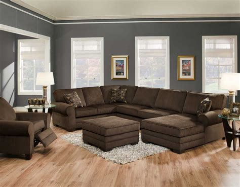 gray and brown living room with dark brown u shape couch