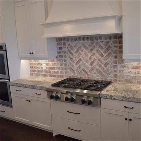 brick tile backsplash kitchen red brick herringbone cooktop backsplash transitional