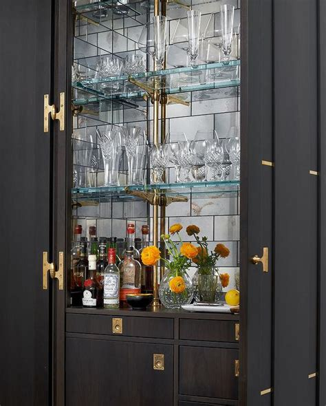 built in bar cabinets stained bar cabinet with mirrored subway tile