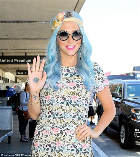 kesha tattoos kesha flashes and flaunts new hair color