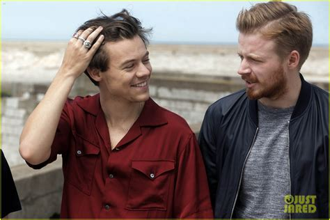 harry styles running his fingers through his hair harry styles makes us swoon at dunkirk photo call