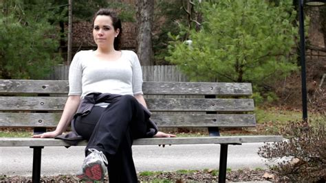 sitting on a park bench song girl sitting on park bench stock footage video 704056