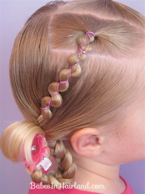 hair braid maid with rubberbands and the hair looks springy rubber band wraps flipped braids looking forward to