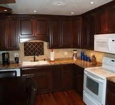 should kitchen cabinets match the hardwood floors cabinets kitchen cabinets and