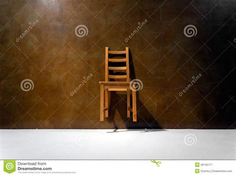 The Chair Is Against The Wall by Empty Chair Against The Wall Royalty Free Stock