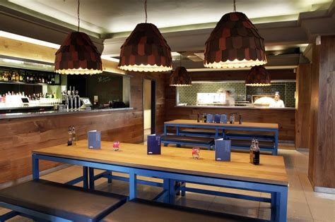 Cool Cafe Interiors by Blue Metallic And Warm Wood Is A Color Combo