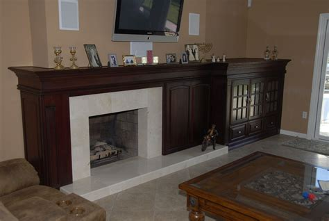handmade custom mantel and entertainment center combo by