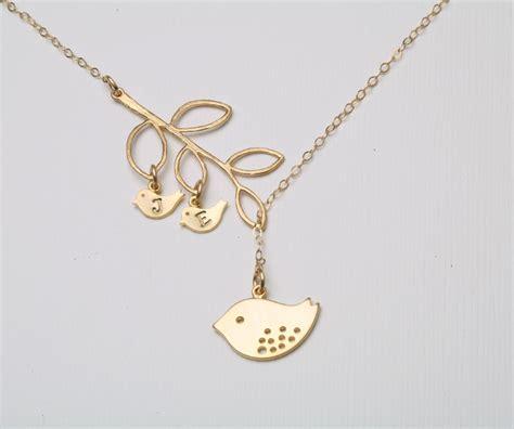 gold bird initial bird necklace and baby