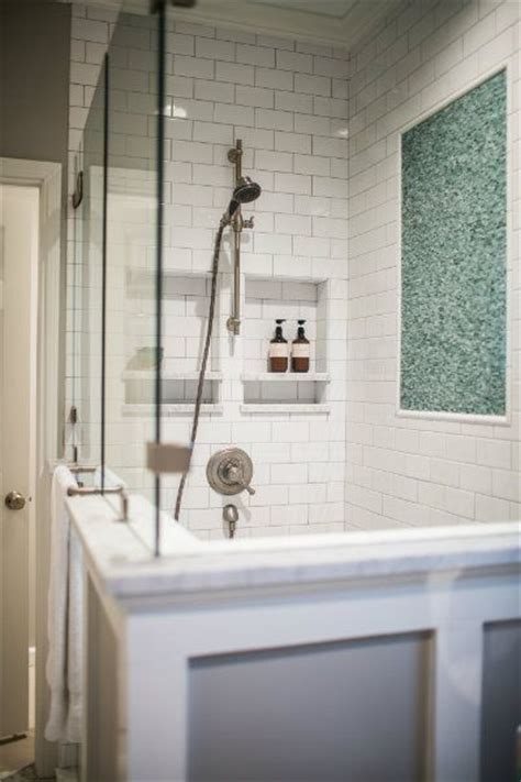 blue and gray bathroom features a walk in shower with