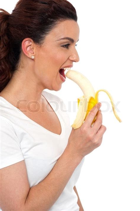 Cracker House Plans side view of brunette women eating banana stock photo