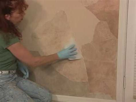is faux painting out of style how to faux apply paper rock wall finish paint technique