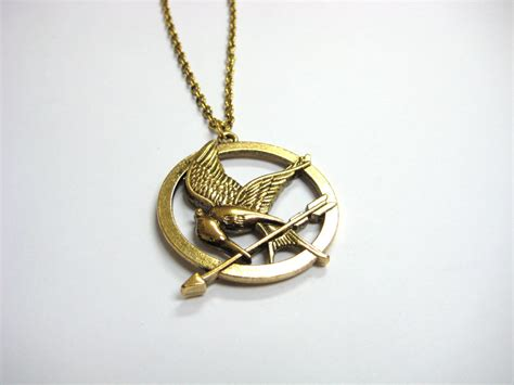 mockingjay necklace hunger inspired the clutter shop