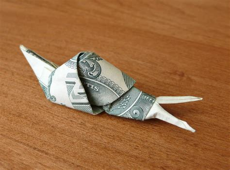 Origami Snail - dollar bill origami snail by craigfoldsfives on deviantart
