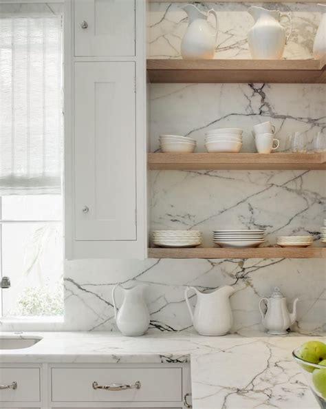 stone slab counters backsplash floating wood shelves