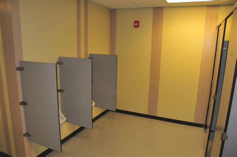 toilet partitions co toilet partitions with special 100mm leg in a timber grain compact laminate closed doors