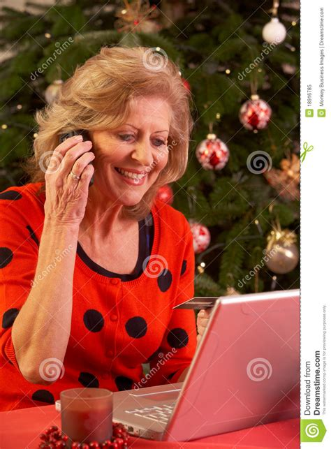 senior woman shopping online for christmas gifts royalty