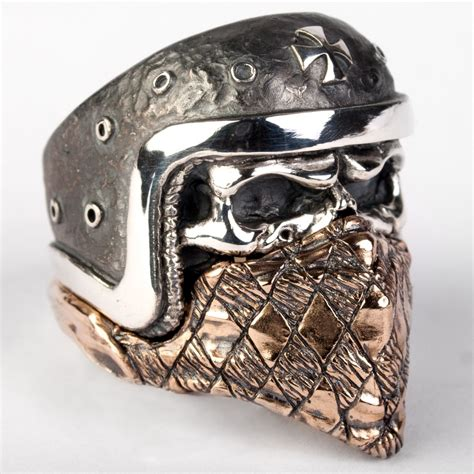 Skull Ring Biker skull ring with an iron cross comes with a