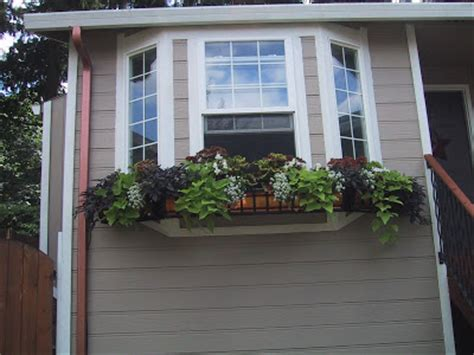 pictures of window boxes copper window box on bay windows - Bay Window Flower Boxes