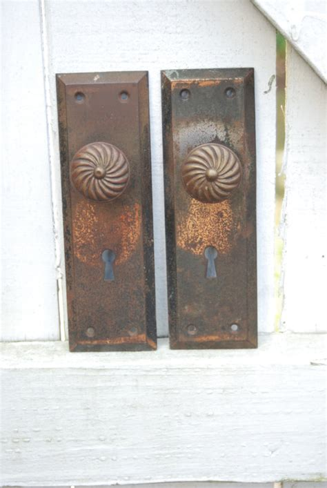 set of two metal door plates and knobs by imprintdesign on