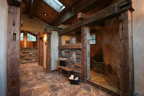 rustic master bathroom with skylight by high c home