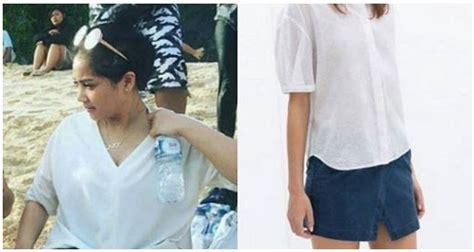 Atasan One Shoulder Nagita Slavina wow nagita slavina pergi ke pantai pakai skort netizen