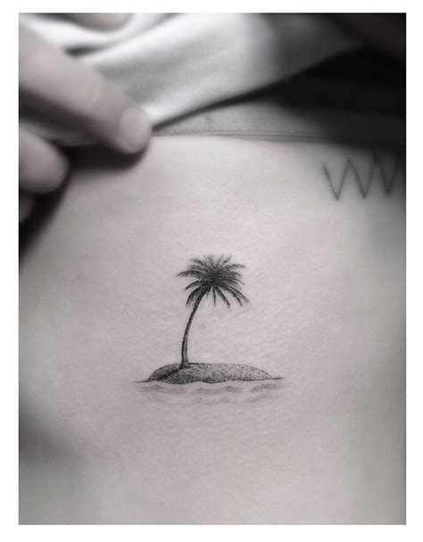 tiny palm tree tattoo skulls on palm tree on side rib