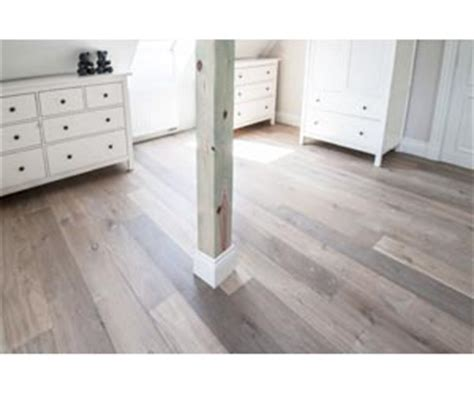 Grey Kitchens by The Secret To Laying Floorboards Over Tiles