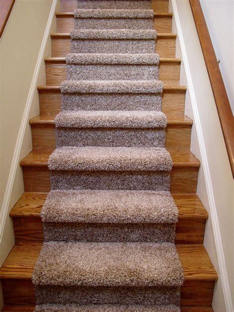 beautiful carpet runner  wooden stairs  nice blue