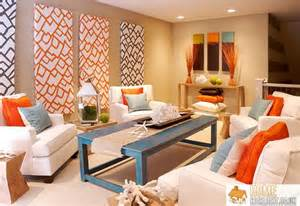 Orange and blue cushions combined with a cream sofa set it all off