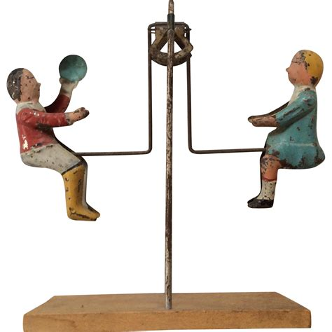 toy swing antique swinging tin doll toy boy girl swing from