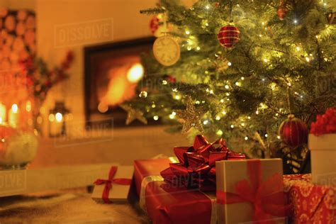 gifts  christmas tree  ambient living room  fireplace stock photo dissolve