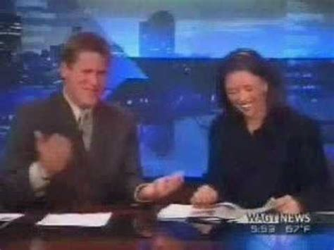 funny news reader cannot stop laughing at model falling funny newscast youtube