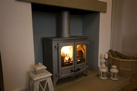Wood Stove Inside Fireplace by Large Fireplace With Log Burner Grey Blue Inside