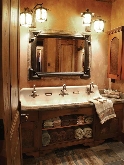 a cast iron trough sink with three faucets adds antique flair to this warm rustic bathroom