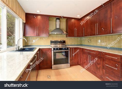Cleaning Top Of Kitchen Cabinets Clean Style Kitchen Stained Wood Cabinets Stock Photo 304235492