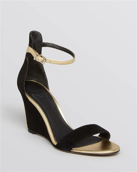 black and gold sandals b brian atwood wedge sandals roberta in gold black gold