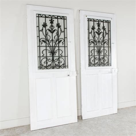 Exterior Door Grilles by Two Solid Oak Entry Doors With Nouveau Iron
