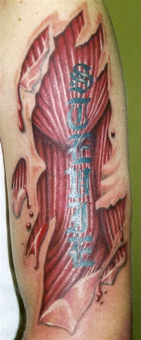 flesh colored tattoo torn flesh colored ink biomechanical on left half