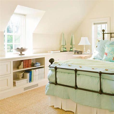 built in bedroom storage low built ins under sloped ceiling