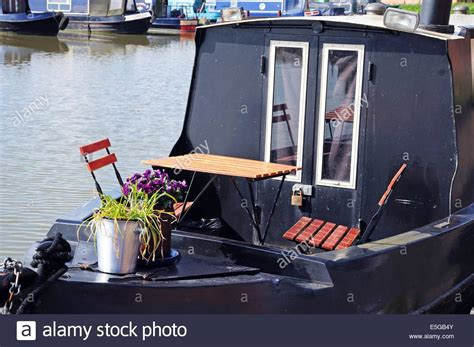 small table with two chairs small table with two chairs on a narrowboat in the canal