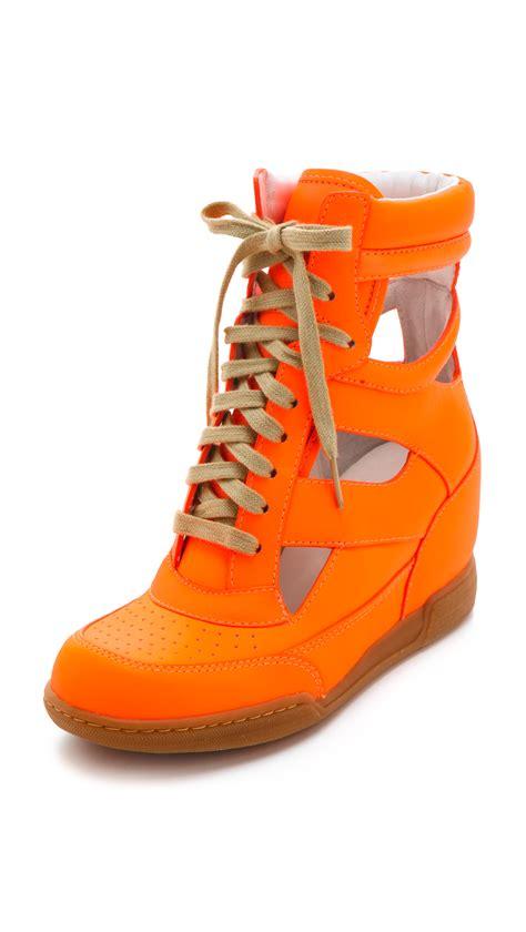 neon orange sneakers marc by marc neon cutout wedge sneakers in orange
