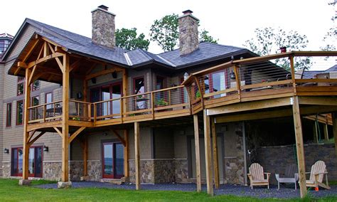 Country House With Wrap Around Porch by Timber Frame Timber Frame Porches New Energy Works