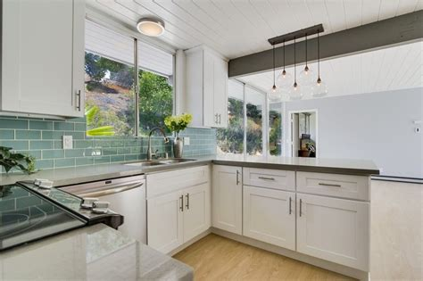 white glass subway tile kitchen contemporary with bread mid century modern kitchen with white cabinets quartz