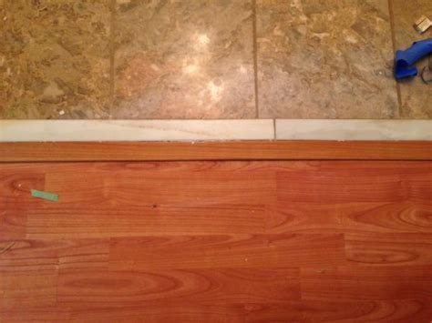 Laminate against tile when tile has transition already